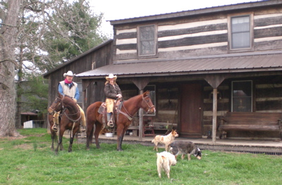 Cowboys cowgirls by  log house